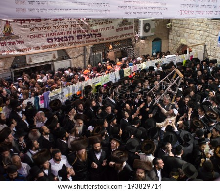 MERON, ISRAEL - MAY 18, 2014: Orthodox Jews dance at the annual hillulah of Rabbi Shimon Bar Yochai, in Meron, on Lag BaOmer Holiday. This is an annual celebration at the tomb of Rabbi Shimon - stock photo