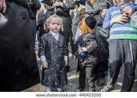 "MERON,ISRAEL- MAY 26, 2016: Two sweet little children waits for Grand Rabbi of Toldos Aharon to light ritual bonfire during the annual ""hilula"" celebration of Rabbi Shimon Bar Yochai in meron 2016"