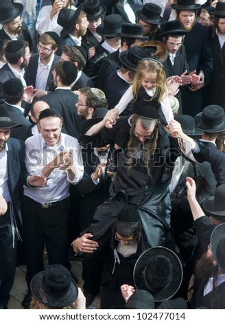 MERON , ISRAEL - MAY 10 : unidentified Orthodox Jews celebrates Halake in Bar Yochai tomb in Meron , Israel on May 10 2012 , Halake is first haircut ceremony celebrated in Lag Ba'omer - stock photo