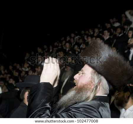 MERON , ISRAEL - MAY 10 : unidentified Orthodox Jews celebrates Lag Ba'omer in Bar Yochai tomb in Meron , Israel on May 10 2012 , Lag Ba'omer is a Jewish holiday in wich it is customary to light bonfire - stock photo