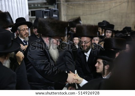 "meron,Israel-November 9,2016 - Grand Rabbi Eliezer Zev of the Nadvorna dynasty holds traditional Hasidic ""tisch"" in which unidentified Hasidic Jewish followers come to reap abundance and blessings"