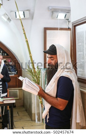 meron,Israel - October 19,2016- Orthodox Jews performing the commandment of taking of the Four Kinds on Sukkot holiday ( etrog, lulav, myrtle and willow ).