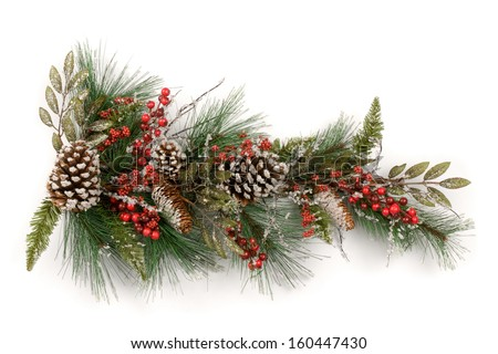 Merry Christmas and Happy New Year. A Christmas garland made from conifer sprigs with red berries  and pine cones on a white background.  - stock photo