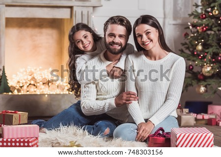 Merry Christmas And Happy New Year Beautiful Mom Dad Daughter Are Hugging