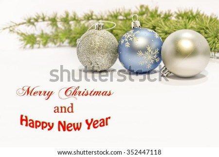 Merry Christmas and Happy new year blue and gray decorative ball on the white background