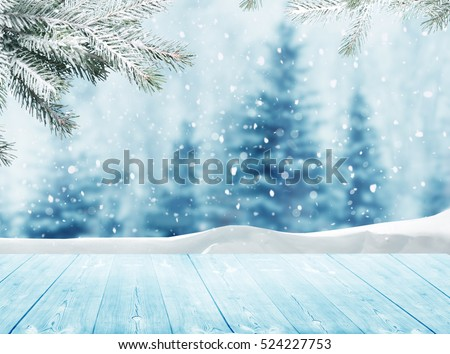 Merry christmas and happy new year greeting background with table .Winter landscape with snow and christmas trees