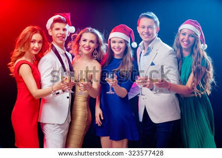 Merry Christmas and Happy New Year! Party and celebration. Group of six happy smiling friends having fun together in the nightclub. - stock photo