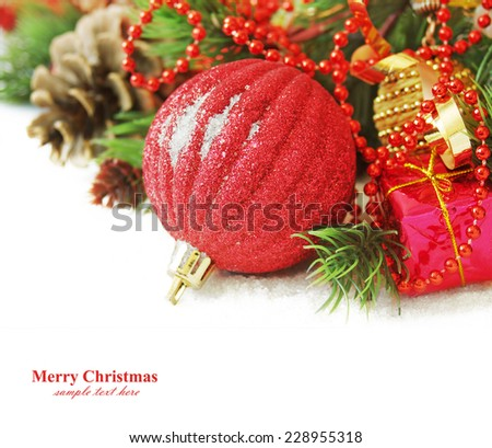Merry Christmas and Happy New Year (still life with new year ball, gifts and decorations isolated on white background) - stock photo