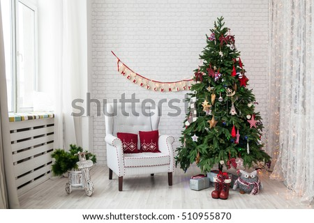Merry christmas and new year background. Classic green tree decorated in christmas toys.