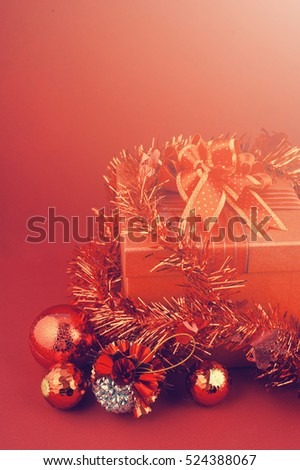 Merry Christmas card on Christmas gift box with decorations and card on red background.Vintage Tone