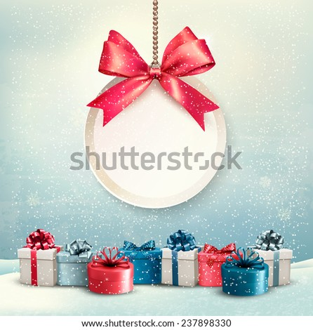 Merry Christmas card with a ribbon and gift boxes. - stock photo