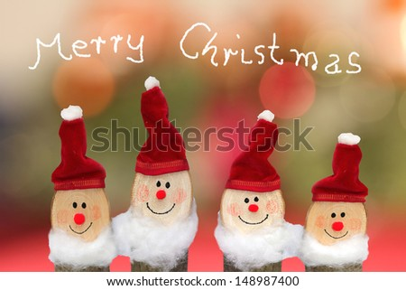 Merry Christmas Card with four smiling gnomes - stock photo