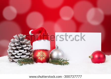 Merry Christmas card with ornaments, red balls, hat decoration, snow and copyspace