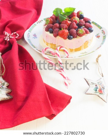 Merry Christmas Cheesecake with Berries - stock photo