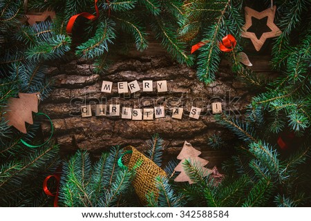 Merry Christmas. Christmas greeting card with rustic wood and ornaments. Xmas backgroud. - stock photo
