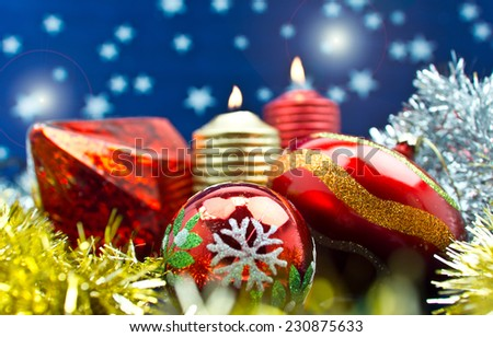 Merry Christmas/composition Christmas decorations with lit candles and starry background