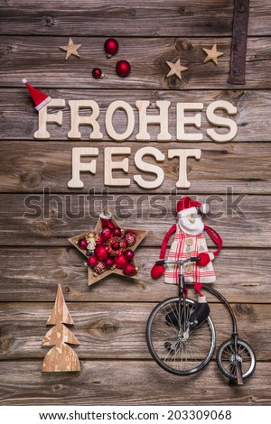 """Merry Christmas """"Frohes Fest"""" in german letters. Greeting card with wood, red and white. - stock photo"""