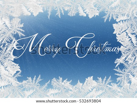 Merry Christmas greeting in frosty ice frame on blue