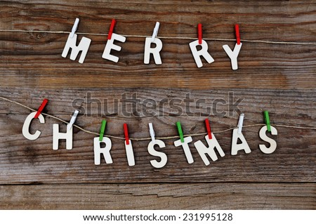 Merry Christmas greeting message on wooden background - stock photo