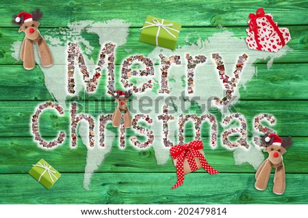 Merry christmas greetings with text on green wooden background - letters of different xmas images. - stock photo