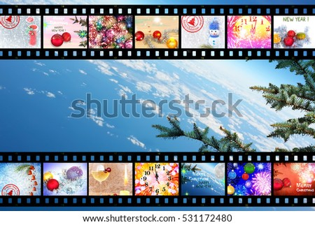 Merry Christmas. Happy New Year. Celebration. Winter Holidays. Christmas tree decorations. Fireworks,fairy stars and sparkles. Festive images designed in film strip. Blue sky space background