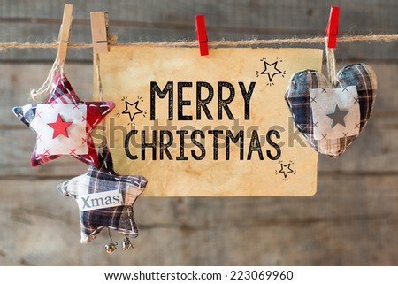 Merry christmas inscription. Merry Christmas inscription on aged paper attach to rope  - stock photo