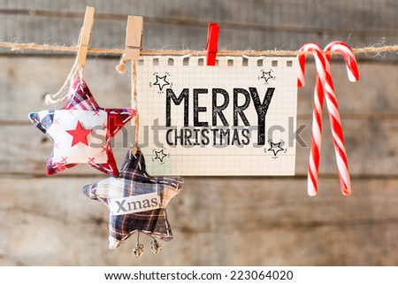 Merry christmas inscription. Merry Christmas inscription on checkered paper attach to rope  - stock photo