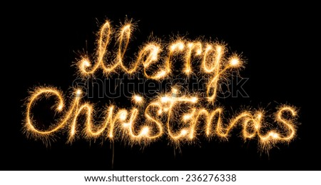 Merry christmas made of sparkles on black background - stock photo