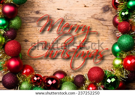 Merry Christmas message surrounded by christmas decoration - stock photo