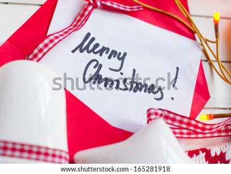 Merry Christmas note among holiday decoration