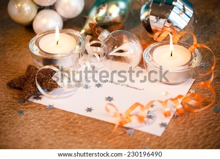 Merry Christmas note surrounded by christmas decoration. - stock photo