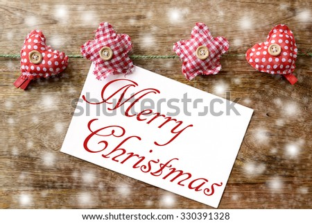 merry christmas on wood with clothespins - stock photo