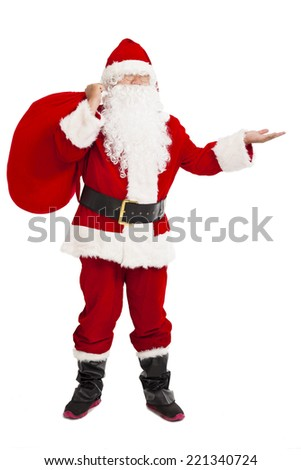 merry Christmas Santa Claus holding gift bag and showing over white background - stock photo