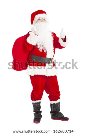 merry Christmas Santa Claus holding gift bag with thumb up - stock photo