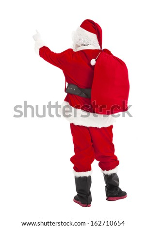 merry Christmas Santa Claus pointing and rear view - stock photo