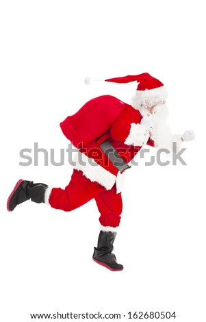 merry Christmas Santa Claus running and delivery - stock photo