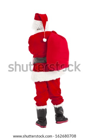 merry Christmas Santa Claus standing and back view - stock photo