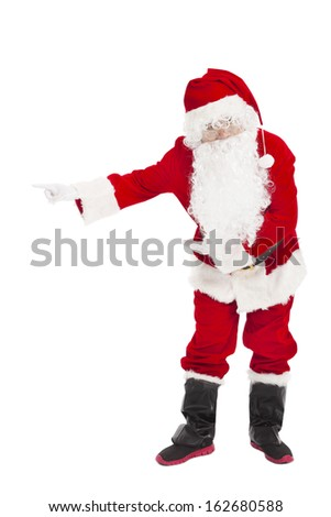 merry Christmas Santa Claus with welcome gesture - stock photo