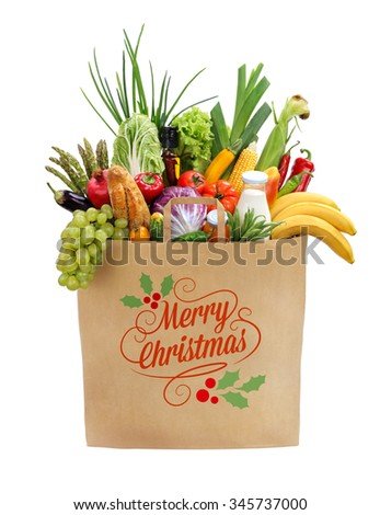 Merry christmas shopping bag / studio photography of brown grocery bag with fruits, vegetables, bread, bottled beverages - isolated over white background - stock photo