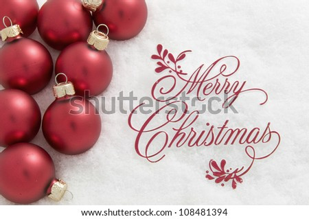 Merry Christmas Sign and Ornaments in Snow - stock photo