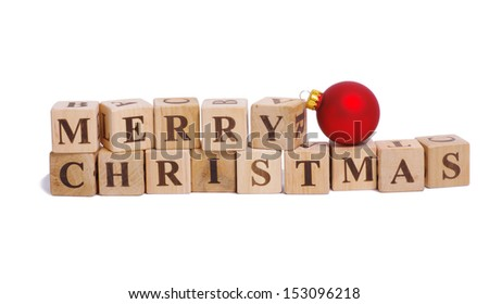 merry christmas spelled out in wooden blocks - stock photo