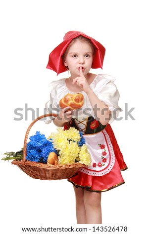 Merry emotional girl holding a basket of cakes and chrysanthemums