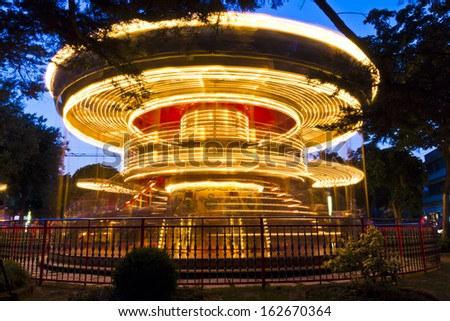 Merry-go-round carousel at night, Lignano Sabbiadoro, Italy - stock photo