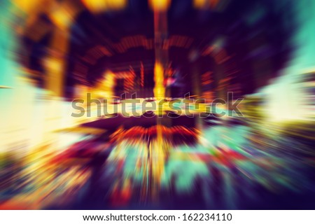 Merry-go-round, carousel in motion. Vintage, retro style - stock photo