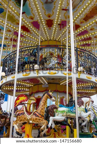 Merry go round in carnival vertical - stock photo