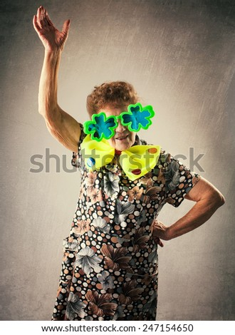 Merry old woman. Happy fun granny. Adult funny dancing female on party - stock photo