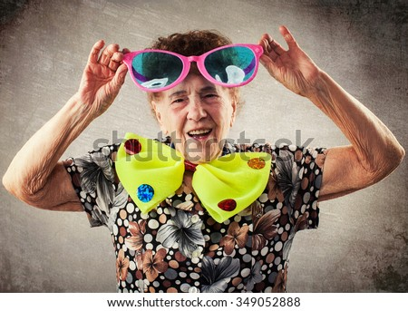 Merry old woman. Happy fun granny. Adult funny female on party - stock photo