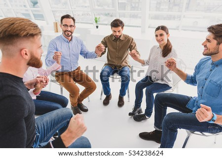 Merry people sitting in circle