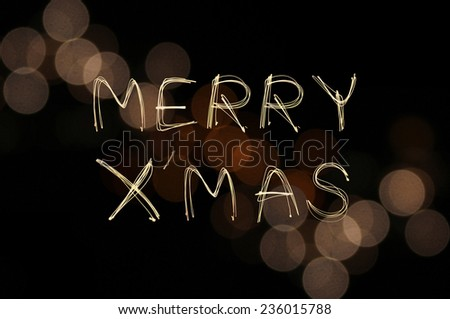 Merry X' Mas sparkle firework with defocused light blur gold bokeh background - stock photo