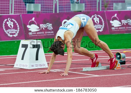 MERSIN - TURKEY - JUNE 29: Unidentified Slovenian athlete start at the 100 m. race competes at the Mediterranean Games Championships June 29, 2013 in Mersin Turkey  - stock photo